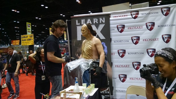 The KOSART booth with Anthony from Face/Off doing a live make up.
