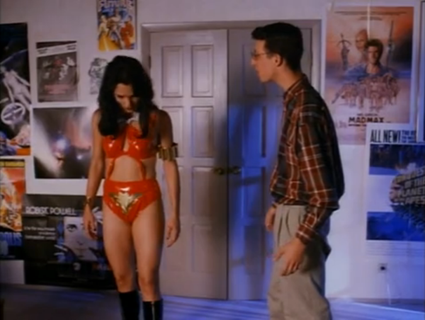 She seems as baffled by her costume as he is.